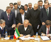 Vahid Salemi/AP -- Signing of Brazil-Turkey-Iran Nuclear Agreement